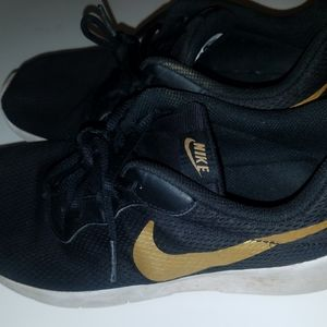 Nike 6.5Y. Black, Gold and White Soles.